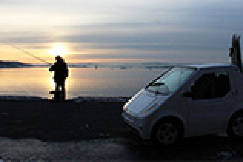 Fotokonkurranse: Elbil i solnedgang